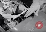 Image of Charlie McCarthy driving a car Princeton New Jersey USA, 1953, second 14 stock footage video 65675041357
