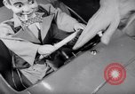 Image of Charlie McCarthy driving a car Princeton New Jersey USA, 1953, second 15 stock footage video 65675041357