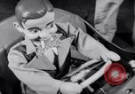 Image of Charlie McCarthy driving a car Princeton New Jersey USA, 1953, second 16 stock footage video 65675041357