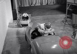 Image of Charlie McCarthy driving a car Princeton New Jersey USA, 1953, second 26 stock footage video 65675041357