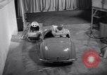 Image of Charlie McCarthy driving a car Princeton New Jersey USA, 1953, second 27 stock footage video 65675041357