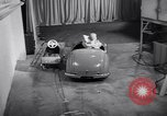 Image of Charlie McCarthy driving a car Princeton New Jersey USA, 1953, second 28 stock footage video 65675041357