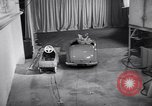 Image of Charlie McCarthy driving a car Princeton New Jersey USA, 1953, second 29 stock footage video 65675041357