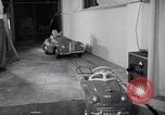 Image of Charlie McCarthy driving a car Princeton New Jersey USA, 1953, second 33 stock footage video 65675041357