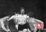 Image of underwater boxing Silver Springs Florida USA, 1954, second 1 stock footage video 65675041495