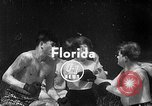 Image of underwater boxing Silver Springs Florida USA, 1954, second 4 stock footage video 65675041495