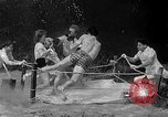 Image of underwater boxing Silver Springs Florida USA, 1954, second 10 stock footage video 65675041495