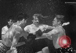 Image of underwater boxing Silver Springs Florida USA, 1954, second 25 stock footage video 65675041495