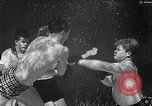 Image of underwater boxing Silver Springs Florida USA, 1954, second 26 stock footage video 65675041495