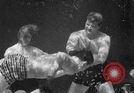 Image of underwater boxing Silver Springs Florida USA, 1954, second 27 stock footage video 65675041495