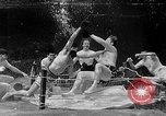 Image of underwater boxing Silver Springs Florida USA, 1954, second 36 stock footage video 65675041495