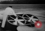 Image of flying scooters Princeton New Jersey USA, 1959, second 18 stock footage video 65675041631