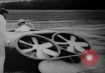 Image of flying scooters Princeton New Jersey USA, 1959, second 19 stock footage video 65675041631