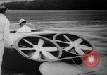 Image of flying scooters Princeton New Jersey USA, 1959, second 20 stock footage video 65675041631