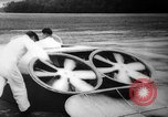 Image of flying scooters Princeton New Jersey USA, 1959, second 23 stock footage video 65675041631
