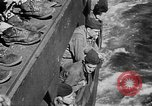 Image of United States Coast Guard transports carry amphibious forces Guadalcanal Solomon Islands, 1942, second 60 stock footage video 65675041744