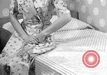 Image of dress and stockings United States USA, 1938, second 1 stock footage video 65675041916