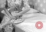 Image of dress and stockings United States USA, 1938, second 2 stock footage video 65675041916