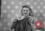 Image of dress and stockings United States USA, 1938, second 7 stock footage video 65675041916