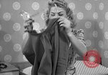 Image of dress and stockings United States USA, 1938, second 8 stock footage video 65675041916