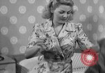 Image of dress and stockings United States USA, 1938, second 9 stock footage video 65675041916