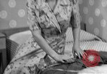 Image of dress and stockings United States USA, 1938, second 10 stock footage video 65675041916