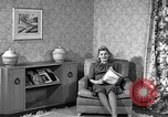 Image of dress and stockings United States USA, 1938, second 14 stock footage video 65675041916