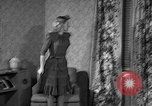 Image of dress and stockings United States USA, 1938, second 21 stock footage video 65675041916