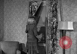 Image of dress and stockings United States USA, 1938, second 23 stock footage video 65675041916