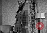 Image of dress and stockings United States USA, 1938, second 24 stock footage video 65675041916
