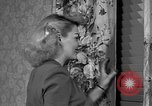 Image of dress and stockings United States USA, 1938, second 39 stock footage video 65675041916