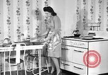Image of housewife in 1930s United States USA, 1938, second 1 stock footage video 65675041917