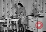 Image of housewife in 1930s United States USA, 1938, second 2 stock footage video 65675041917