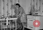 Image of housewife in 1930s United States USA, 1938, second 3 stock footage video 65675041917