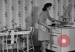 Image of housewife in 1930s United States USA, 1938, second 4 stock footage video 65675041917