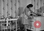 Image of housewife in 1930s United States USA, 1938, second 5 stock footage video 65675041917