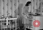 Image of housewife in 1930s United States USA, 1938, second 7 stock footage video 65675041917