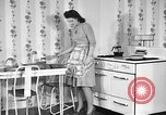 Image of housewife in 1930s United States USA, 1938, second 9 stock footage video 65675041917