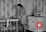 Image of housewife in 1930s United States USA, 1938, second 10 stock footage video 65675041917