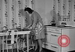 Image of housewife in 1930s United States USA, 1938, second 11 stock footage video 65675041917