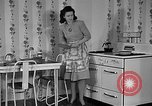 Image of housewife in 1930s United States USA, 1938, second 12 stock footage video 65675041917