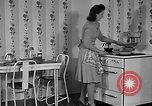 Image of housewife in 1930s United States USA, 1938, second 13 stock footage video 65675041917