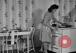 Image of housewife in 1930s United States USA, 1938, second 14 stock footage video 65675041917