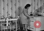 Image of housewife in 1930s United States USA, 1938, second 15 stock footage video 65675041917