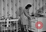 Image of housewife in 1930s United States USA, 1938, second 16 stock footage video 65675041917