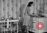 Image of housewife in 1930s United States USA, 1938, second 17 stock footage video 65675041917