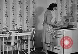Image of housewife in 1930s United States USA, 1938, second 18 stock footage video 65675041917