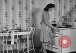 Image of housewife in 1930s United States USA, 1938, second 19 stock footage video 65675041917