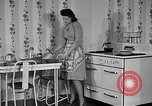 Image of housewife in 1930s United States USA, 1938, second 20 stock footage video 65675041917