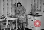 Image of housewife in 1930s United States USA, 1938, second 22 stock footage video 65675041917